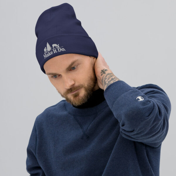 Guy wearing a Gifts For Men dark green beanie hat featuring the Make It Do® Hunter Logo